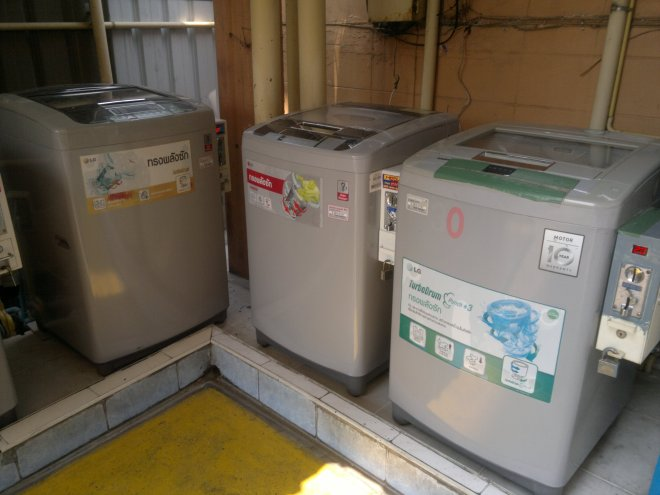 A typical set of washing machines outside a block of flats