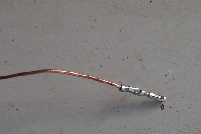 Female connectors soldered to stiff copper wire